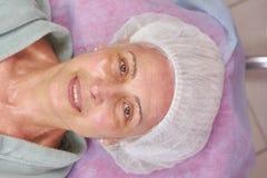 Mature beauty clinic patient smiling. Stock Photos