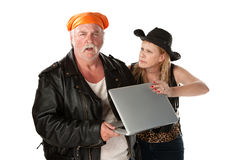 Mature Biker Couple Arguing about a Computer Royalty Free Stock Photo