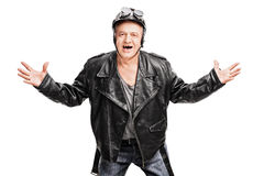 Mature biker gesturing with his hands Stock Photography