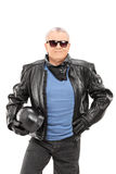 Mature biker in a leather jacket holding a helmet Royalty Free Stock Images