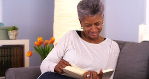 Mature Black woman enjoying a good book Royalty Free Stock Images