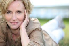 Free Mature Blonde Lying On Grass Stock Image - 29296971