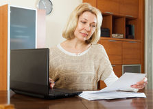 Mature blonde woman with documents Royalty Free Stock Photo