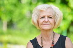 Mature, blonde woman. Royalty Free Stock Image