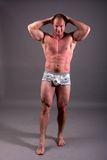 Mature bodybuilder posing Royalty Free Stock Images