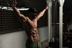 Mature Bodybuilder Is Working On His Chest Stock Photography