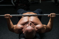 Mature Bodybuilder Is Working On His Chest Royalty Free Stock Image