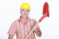 Mature bricklayer holding shovel Royalty Free Stock Images