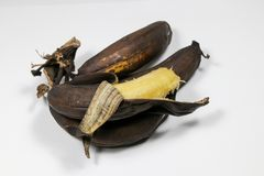 Mature brown banana. A long curved fruit that grows in clusters and has soft pulpy flesh and yellow skin when ripe Royalty Free Stock Photo