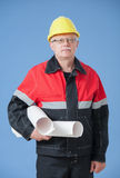 Mature builder holding projects Stock Photos