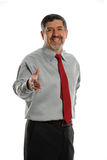 Mature Businesman offering handshake Royalty Free Stock Image
