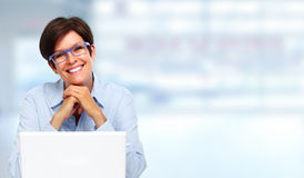 Mature business lady with laptop. Stock Photos