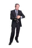 Mature business man checking time. Isolated on white royalty free stock image