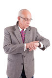 Mature business man consulting his watch royalty free stock photos