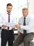 Mature business man discussing with his colleague Stock Photography