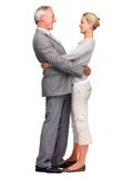 Mature business man embracing wife over white Stock Photos