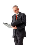 Mature business man with folder, reading. Isolated mature business man with folder, reading royalty free stock image