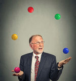 Mature business man juggling multitasking Royalty Free Stock Photo