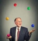 Mature business man juggling multitasking. Portrait mature business man juggling multitasking Royalty Free Stock Photo