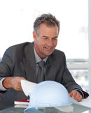 Mature Business man looking at Blueprints Royalty Free Stock Image