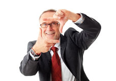 Mature business man makes sign with hands Royalty Free Stock Photo