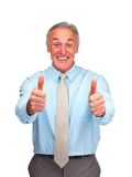Mature business man showing a thumbs up over white Royalty Free Stock Photography