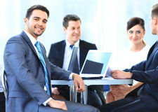 Mature business man smiling during meeting with colleagues Stock Photo