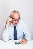 Mature business man. Speaking on the phone Stock Photo