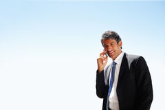 Mature business man speaking on the phone Royalty Free Stock Photo