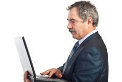 Mature business man type on laptop Royalty Free Stock Photo