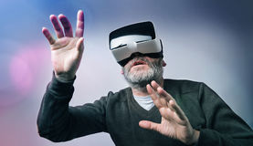 Mature business man wearing virtual reality googles / VR Glasses Stock Photos