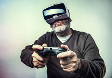 Mature business man wearing virtual reality googles / VR Glasses Stock Images