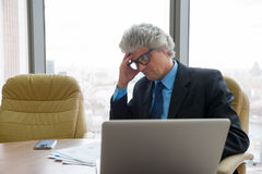 Mature business man works with docs Royalty Free Stock Images