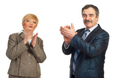 Mature business people applauding. Two happy mature business people applauding isolated on white background Royalty Free Stock Photography