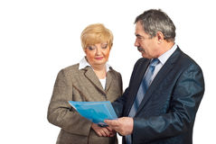 Mature business people discuss contract Royalty Free Stock Photos