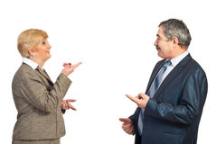 Mature business people in funny conflict Royalty Free Stock Photos