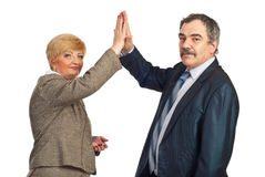 Mature business people give high five Royalty Free Stock Images
