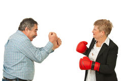 Mature business people having confrontation. Two mature business people having confrontation isolated on white background Stock Images