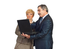Mature business people using laptop Stock Photo