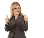 Mature business woman. Beautiful mature woman showing thumbs up on white background Royalty Free Stock Photography