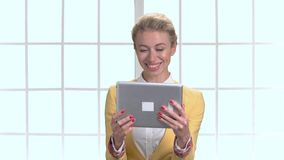 Mature business woman chatting with someone using tablet. stock video
