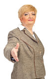 Mature business woman give handshake Royalty Free Stock Photography