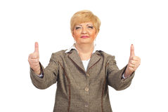 Mature business woman giving thumbs up Royalty Free Stock Photography