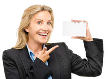Mature business woman holding white placard pointing Stock Images