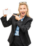 Mature business woman holding white placard pointing Royalty Free Stock Image