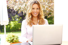 Mature business woman with laptop Stock Image