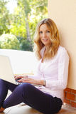 Mature business woman with laptop Stock Images