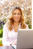 Mature business woman with laptop Royalty Free Stock Photography