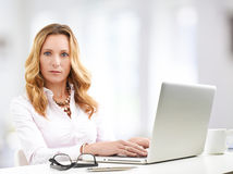 Mature business woman with laptop Royalty Free Stock Photo