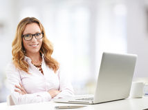 Mature business woman with laptop Royalty Free Stock Images